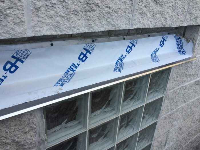 Installation glass blocks and window flashing system with drip edges by Gralak Waterproofing Contractors