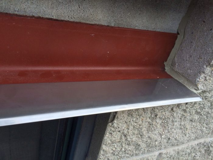 Stainless steel drip edge installed by Gralak Licensed Masonry Experts