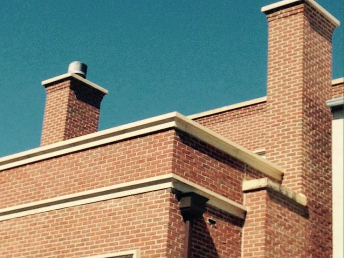 Tuckpointing and new chimneys cap project on Cleveland Street