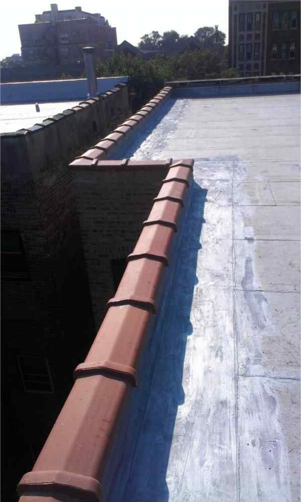 Clay copings on the parapet walls with flashing  tuckpointing and waterproofing services by Gralak Masonry Contractors